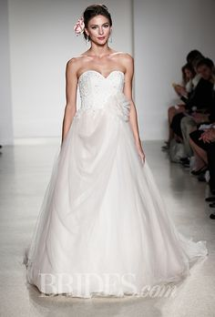 """Brides.com: . Style 245, """"Sleeping Beauty"""" strapless draped tulle ball gown wedding dress with a beaded lace sweetheart bodice and a floral detail at the hip, Alfred Angelo"""