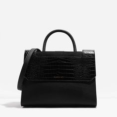 Charles & Keith: Structured top handle work bag with magnetic snap closure. Comes with an additional strap for versatility.