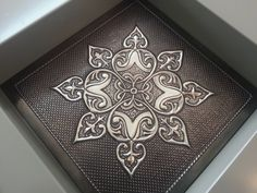 Another design done by Heather using different textures finishing of the design beautifully. Frame techniqued to give a rope effect.