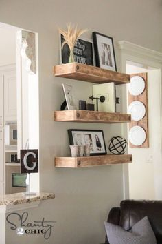 I would really love to incorporate something like this into our home. DIY Floating Shelves - Shanty2Chic
