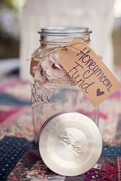 Honeymoon Funds mason jar wedding ideas /  / http://www.deerpearlflowers.com/50-ways-to-incorporate-mason-jars-into-your-wedding/3/
