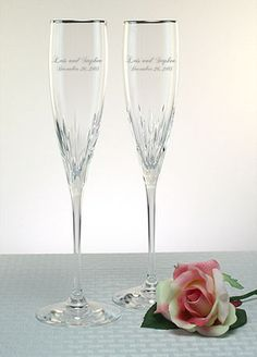 Champagne glasses  http://www.davidsbridal.com/Product_Personalized-Lenox-Firelight-Platinum-Rim-Flutes-DB818209A_Reception-and-Favors-Wedding-Reception-Toasting-Flutes