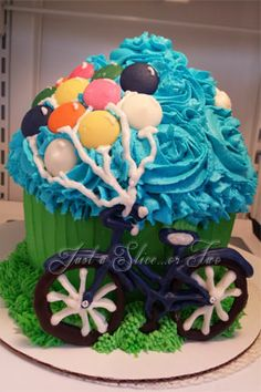 Bicycle Cake for my Mom & Uncle ~ chocolate bicycle and balloons on a giant cupcake covered in buttercream