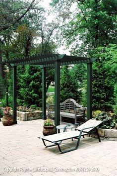 Small pergola over bench in patio area: Poynter Landscape Architecture