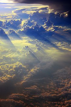 Luminous rays pour from assure clouds. An active, moving painting.