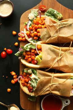 AMAZING Buffalo Chickpea Wraps! Spicy chickpeas, crispy vegetables, soft pita #vegan #recipe #plantbased #spicy #healthy #minimalistbaker Healthy Meals To Cook, Healthy Diet Recipes, Lunch Recipes, Whole Food Recipes, Vegetarian Recipes, Healthy Eating, Baker Recipes, Lunch Meals, Vegetarian Lunch