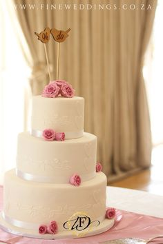 This elegant 3 tier wedding cake features soft pink sugar roses and custom 'We Do' cake toppers. Sugar Rose, Pink Sugar, 3 Tier Wedding Cakes, Carrot Cake, Cake Toppers, Roses, Weddings, Elegant, Desserts