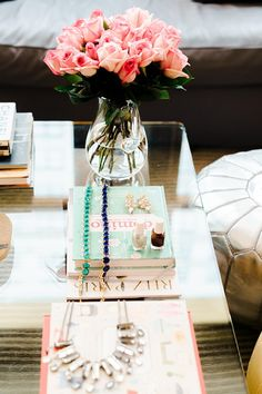 Gorgeous table top styled with books and flowers