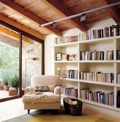 The most incredible reading area! Windows, exposed beams and floor to ceiling books :)