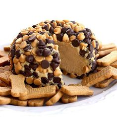 "Peanut Butter ""Cheese Ball"" Ingredients: 1 package (8 ounces) cream cheese, at room temperature 1 cup powdered sugar 3/4 cup creamy peanut butter (not all-natural) 3 tablespoons packed brown sugar 3/4 cup milk chocolate chips 3/4 cup peanut butter chips Graham cracker sticks, teddy grahams, and/or apple slices for dipping"