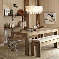 Love this chandelier over the dining table. Rustic with a little flare.