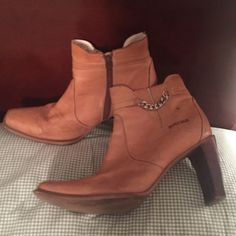 Durango boots Tan leather casual ankle boots. Worn a handful of times. Great quality. Size 8.5. I usually wear 7.5-8. So, these were a little too big. Durango Shoes Ankle Boots & Booties