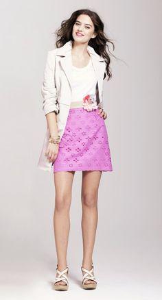 Feminine trench coat and pink eyelet mini skirt