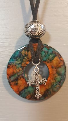 Washer pendant with alcohol ink with a cross charm, bead and cording. Resin Jewelry, Leather Jewelry, Jewelry Crafts, Beaded Jewelry, Bullet Jewelry, Leather Bracelets, Leather Cuffs, Jewelry Necklaces, Alcohol Ink Jewelry