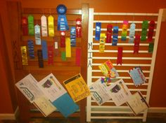 """Yahoo!  I found a way to repurpose my kids' cribs in order to display ribbons and awards earned from swimming, piano, and school.  I removed all hardware from the crib rails, flipped them on their sides, added each child's name, and now they are ready to hang up as each child's own """"wall of fame""""."""