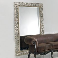 Large classic style floor standing mirror with ornate frame finished in precious silver leaf.