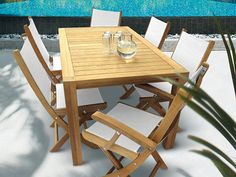 "The Teak 63"" Comfort Dining Set is perfect for the pool or patio."