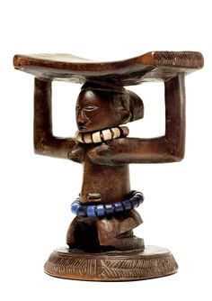 Congo The support shaped in the form of a kneeling female figure, the pillow resting on the two arms folded at. Arte Tribal, Tribal Art, Sculpture Art, Sculptures, South Afrika, Contemporary African Art, Cultural, Ocean Art, Traditional Art