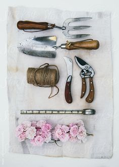 Gardening tools with roses and tape measure on a canvas background by kkgas for Stocksy United