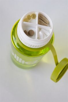 """Nalgene lid that holds supplements (or snacks). So cool!  The Pillid is one of those accessories that makes you think to yourself, """"Why didn't someone think of this sooner?""""  Pillid screws onto the top of a 63mm Nalgene bottle, like our best selling 32oz WM, and can hold small items like pills, or a gym key.  It's like having an extra pocket, or secret compartment."""