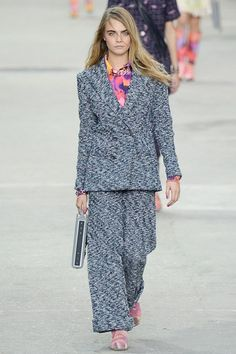 """""""A fabulous fashion protest - Chanel Spring/Summer 2015 - Vogue UK""""  Chanel never disappoints! I love the thick quilted women's suit modeled by the fabulous Cara in this photo. What I Love about Chanel is that it is not only a designer clothing line but also a movement. During the runway show the girls walked with signs protesting for women's rights and everything feminism!"""