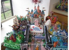 Homemade Disneyland Birthday Cake: I decided to create a Disneyland Birthday Cake and scene for my little boy's 3rd birthday! There were a total of seven cakes with different flavors and