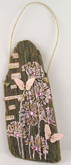 Stamping and embossing on the driftwood.