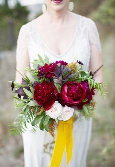 A gorgeous, burgundy peony bouquet | Brides.com