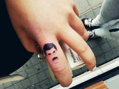 Freddie Mercury Tattoo idea on finger Tatouage Freddie Mercury, Freddie Mercury Tattoo, Bum Tattoo, Ring Tattoos, Dream Tattoos, Future Tattoos, Fred Mercury, Queen Freddie, Small Tattoos