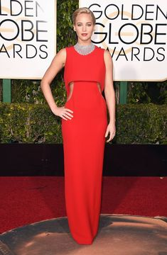 Jennifer Lawrence looked red-hot in a cherry dress with cutouts by Dior Haute Couture. Oh, and a 156-carat diamond necklace. See more of the Golden Globes' best dressed stars here!