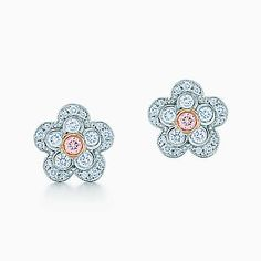 Flower earrings in platinum and rose gold with white and Fancy Pink diamonds.
