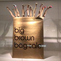Shop 'til you drop @bloomingdales #windowdisplay #vmlife #mannequins #bloomingdales #bigbrownbag #footwear #visualmerchandising #visualmerchandiser #vmdaily via @humans_imperio