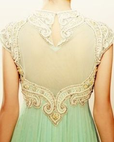 Amazing mint green gown with gold and sheer detailing. Would make a stunning bridal or bridal party gown!