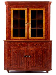 Cowan's 10/17/15 Lot 239. Estimate: $1,000 - $2,000. Winning bid: $6,300. Description: Pennsylvania Paint-Decorated Corner Cupboard, American (probably Adams County, Pennsylvania), mid-19th century. A two-piece corner cupboard in pine and poplar, retaining its original ochre and red grain-painted surface, the upper section having a stepped cornice above two, six-light doors before a red-painted interior with two shelves, the back of the shelves having applied plate strips and the front edge ...
