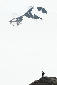 thepinesaredancing:      Distant peaks emerge from the clouds over the Harding Icefield, in Alaska's Kenai Fjords National Park.