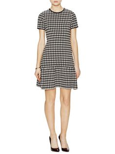 Houndstooth, plus the flared hem.  I would love to have a little dress like this one for spring.  The drop waist helps lengthen my upper half.