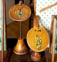 Turn thrift store finds into one of a kind displays like these ping pong paddles turned necklace display.