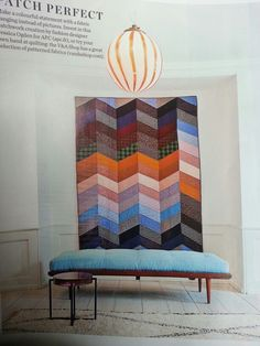 Quilt as art.  Headboard?