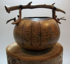 Pine tree pattern burned into a gourd