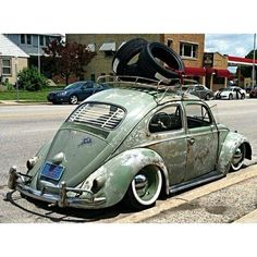 Type 1 old school air-cooled VW patina deep dish narrowed beam wood slat roof rack window blinds overriders into rust