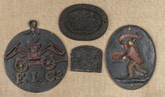 Three cast iron fire marks, largest - 11 3/4'' dia : Lot 257.  Pook & Pook 12/10/13.  $200