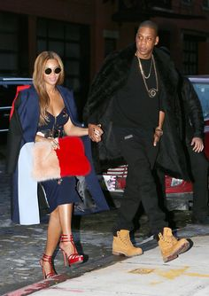 The musical power couple hold hands in New York! Love that purse Bey!