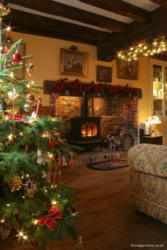 A Cosy Christmas in the Cottage looks like the fireplace we have for our wood stove.love the stove placed in the fireplace Cosy Christmas, Decoration Christmas, Cottage Christmas, Christmas Living Rooms, Christmas Fireplace, Country Christmas, Beautiful Christmas, Christmas Home, Holiday Decor