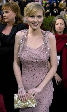 Kirsten Dunst in sequined dress by John Galliano with beaded Corem Rose clutch at the 2002 Oscars | kirsten-d.com.
