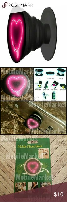 Mobile phone grip/stand melting neon pink heart *this is an individual listing for 1 phone stand, color is according to first picture* Pop, tilt, wrap, grip, collapse, repeat! Mobile phone stent. Have a secure grip while calling, taking selfies, and texting. Not popsocket (pop socket) brand. Use as a phone stand, portrait and landscape mode. and even to wrap your headphones around and prevent tangles and knots!! Retail packaging makes it the perfect gift! Mobile Market Accessories