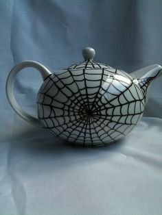 Spider Web Cobweb Teapot -- Inspiration for a DIY project with those Sharpies that you can write on ceramic and bake to set.