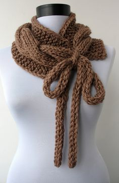 Handknit superchunky cabled neckwarmer - circle scarf - collar -cowl- wrap with long drawstrings-in cappuccino brow. $49.00, via Etsy.