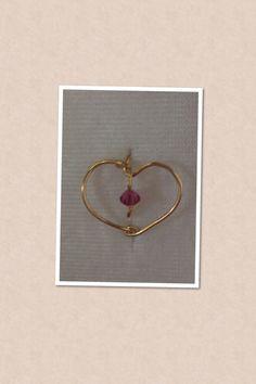 anillo corazón con piedra morada $60