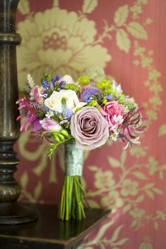 wedding bouquet and vintage wallpaper