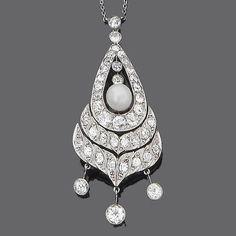A belle époque pearl and diamond pendant,